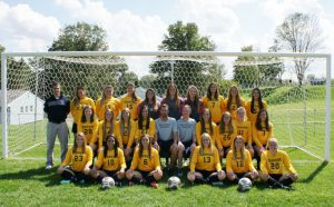 Women's soccer team lends a helping hand