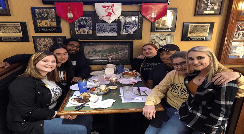 Communications capstone students held successful celebrity server night at Undo's