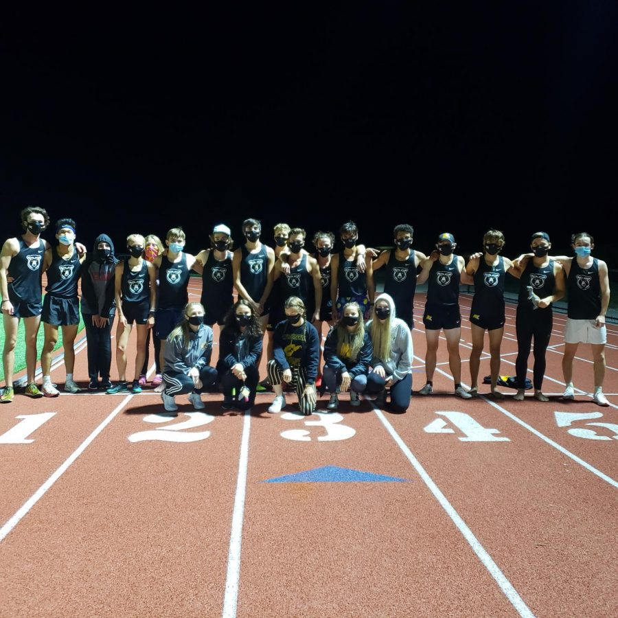 The+2020+cross-country+team+comes+together+to+share+in+a+photo.+Even+though+the+teams+meets+have+thrown+a+wrench+in+their+season+that%27s+not+stopping+them+from+becoming+a+close+team.