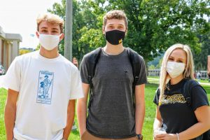 Three West Liberty University students demonstrate proper mask etiquette in preparation for the shift to phase three. This change allows for in-person activities to resume on campus.