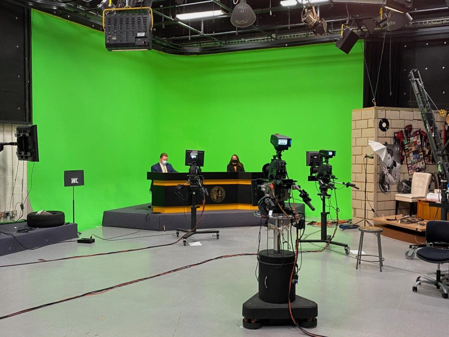 Broadcasting+students+Isaac+Basinger+and+Heather+Hale+getting+ready+for+the+first+live+broadcast+of+the+semester.