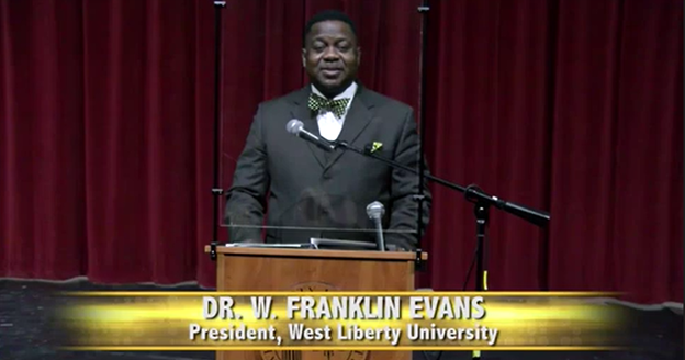 President Dr. W Franklin Evans standing at a podium during Spring Convocation.
