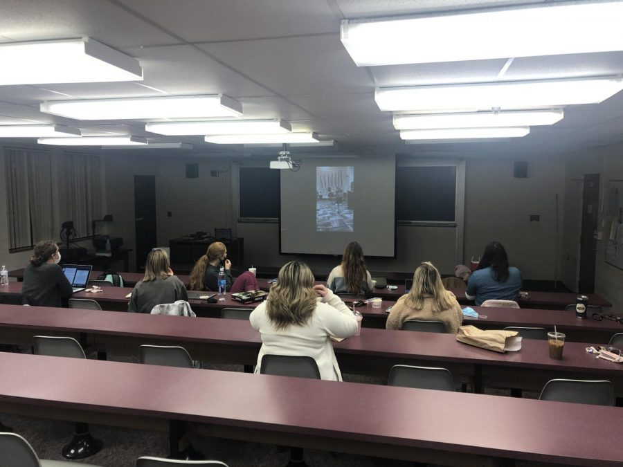 West Liberty students watching Topper Idol together while socially distanced.