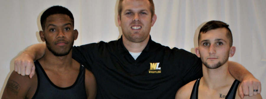 Coach Irwin (center) with two WLU wrestlers.