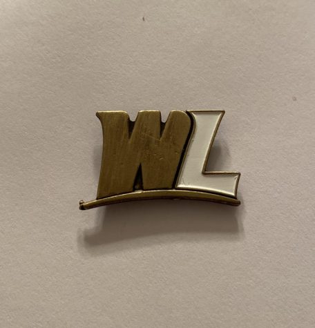 Unique WLU Lapel Pin a graduate will receive upon participating in the Make Your Topper Mark program.