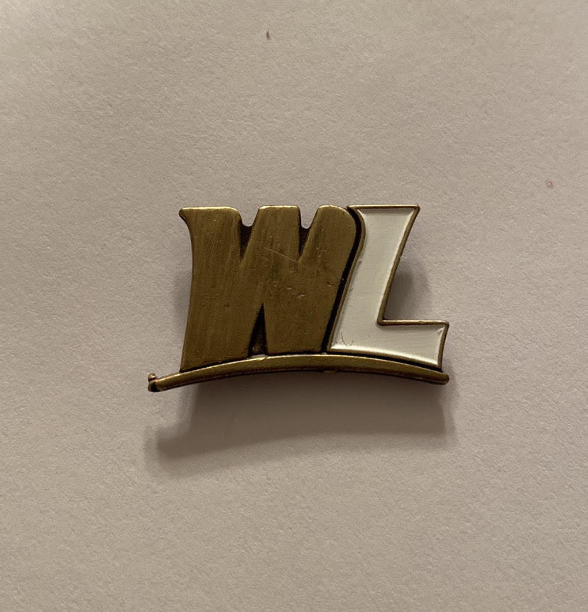 Unique+WLU+Lapel+Pin+a+graduate+will+receive+upon+participating+in+the+Make+Your+Topper+Mark+program.