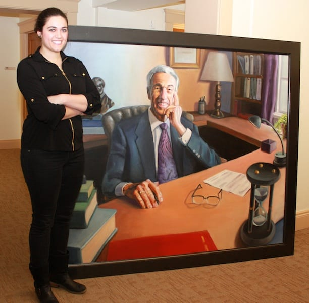 Sophia Kayafas with the painting of former president Campbell Clyde.