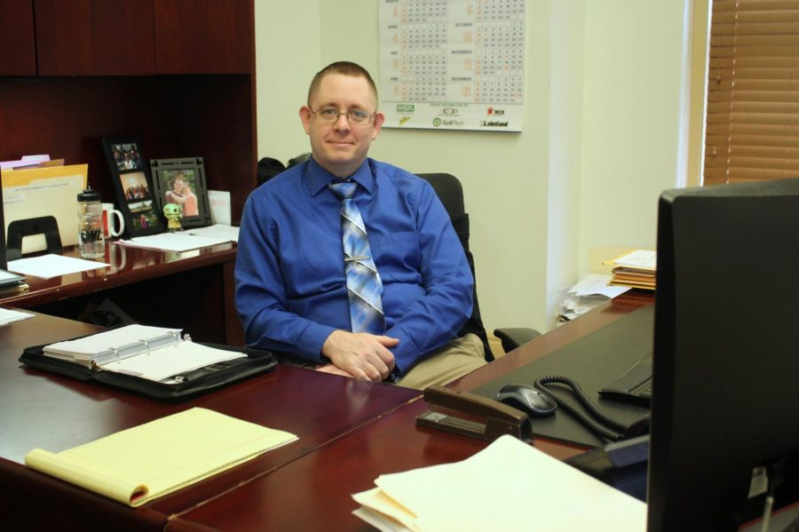 Director of Purchasing Patrick Kelly, MBA is shown at his desk on the third floor of Shaw Hall.