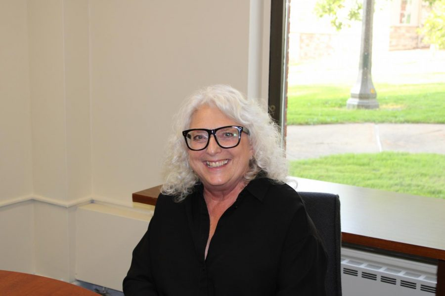 Dr. Cecilia Konchar-Farr, the new dean of the College of Liberal and Creative Arts, is sitting in her new office located in the basement of the Paul N. Elbin library.