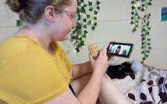 Angelee Kokosinski sitting cozy in bed watching the Cinderella movie.