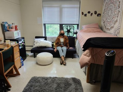 Mikayla Ging relaxing in her dorm room.