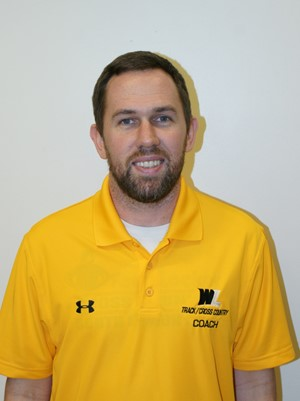 Justin Simpson, the Head Cross Country and Track Coach.
