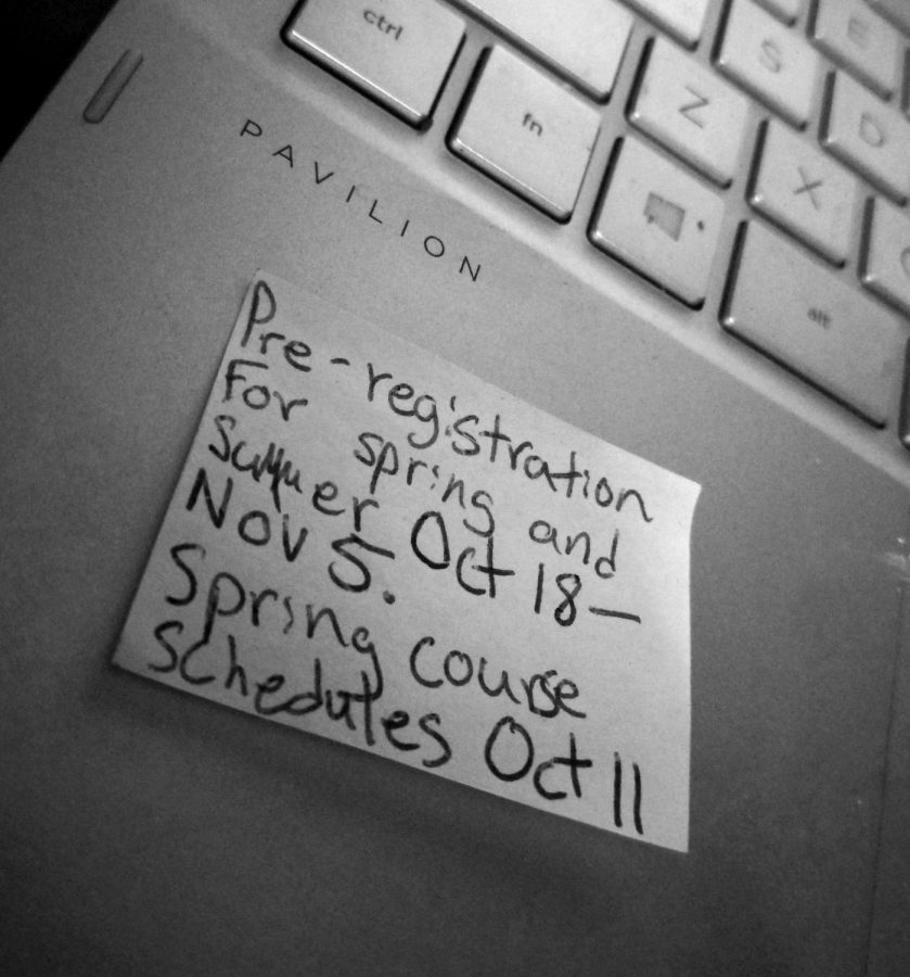 Post-it note of pre-registration dates.