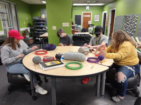 From left to right, Courtney Louk, Nikki Thompson, Rylee Bachmann, and Kiersten Moses enjoying looming together.