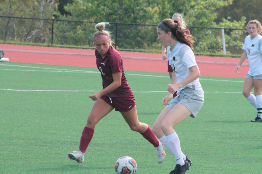 Claire Kelly going against a Wesleyan defender.