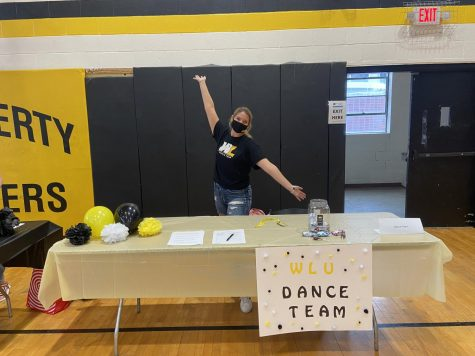 Brooke Anderson promoting the new dance team at the Club and Organization Fair.