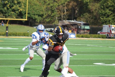 Isaiah Robinson breaks a tackle in the Hilltoppers win against Glenville State.