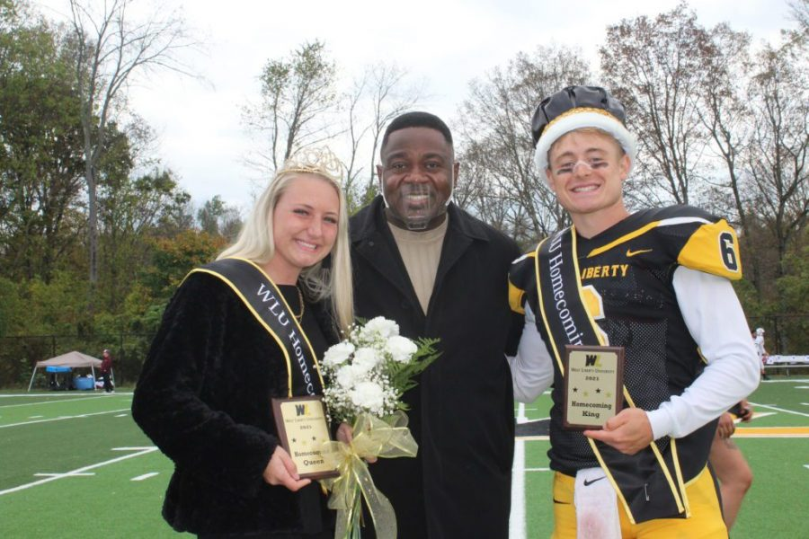 From left, Queen Grace Dodson, President W. Franklin Evans and King Parker Sherry celebrate at the 50-yard line.